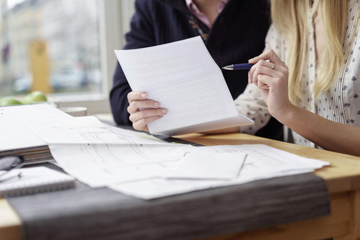 a couple review their will at a kitchener law firm office